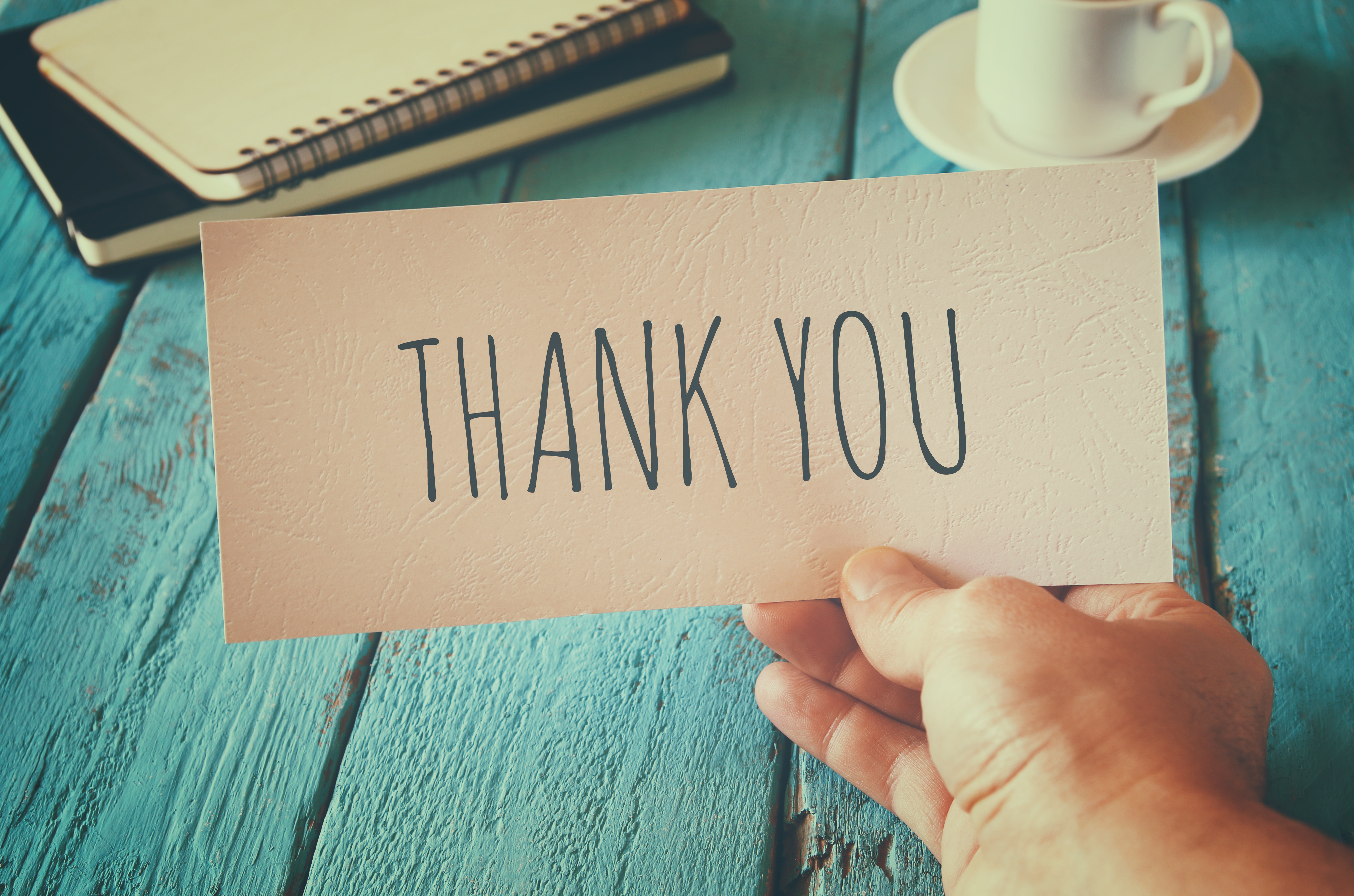 Man Hand Holding Card With The Word Thank You. Retro Style Image